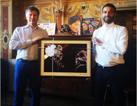 Palio di Siena. Il fotografo del National Geographic Michele Ardu omaggia il Palio: Donata opera aSiena
